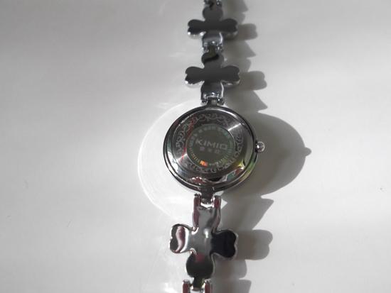 Вид задней крышки часов KIMIO